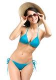 Lady wearing bikini, hat and sunglasses Royalty Free Stock Image
