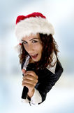 Lady wearing christmas hat and singing Stock Image