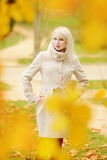 Lady is wearing coat in  fall Royalty Free Stock Images
