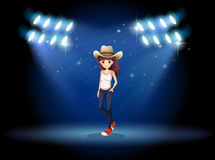 A lady wearing a hat standing at the stage under the spotlights Royalty Free Stock Image