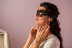 Lady wearing lace mask. Woman with closed eyes. Look gorgeous and charming Stock Image