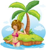 A lady wearing a pink bikini at the beach Royalty Free Stock Photos