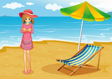 A lady wearing a pink dress at the beach Royalty Free Stock Photos