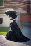 Lady wearing a shiny black victorian royalty free stock images