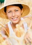 Lady wearing straw hat is in rye field Royalty Free Stock Photos