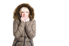 Lady wearing winter jacket with hood being cold Stock Image