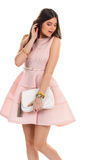 Lady wears light pink dress. Stock Photos