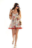 Lady wears sleeveless floral dress. Stock Photography