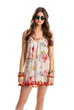 Lady wears white floral dress. Dark round sunglasses and dress. Stylish summer look. Flax garment with stylish accessories Royalty Free Stock Images