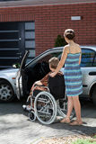 Lady on wheelchair before driving Stock Photography