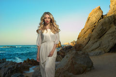 Lady in white dress on seashore Stock Images