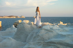 Lady in white dress in an unusual landscape royalty free stock images