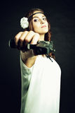 Lady in white with gun Royalty Free Stock Image