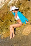 Lady in white hat on the beach Stock Image