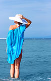 Lady in white hat on the beach Stock Images