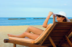 Lady with white hat on the beach Stock Photos