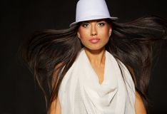 Lady in white hat and blowing hair. Attractive lady in white hat and blowing hair stock images