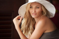 Lady in white hat Royalty Free Stock Images