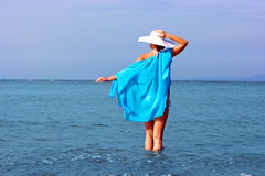 Lady in white hat in water Royalty Free Stock Image
