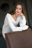 Lady with white long blouse in old factory dark room Stock Photos