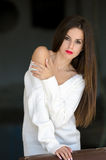 Lady with white long blouse in old factory dark room Royalty Free Stock Photo
