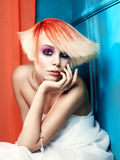 Lady with white-red hair. Beautiful young girl with a white-red hair and fancy make-up Stock Photos