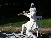 The lady in white singing at the trumpet. On the chair - international festival of the living statues in Bucharest, Romania stock footage