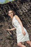 Lady in white sundress inside deep ground quarry Royalty Free Stock Image