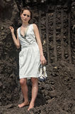 Lady in white sundress inside a deep ground quarry Royalty Free Stock Photography