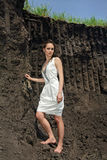 Lady in white sundress inside a deep quarry Royalty Free Stock Photo