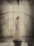 Lady in white vintage dress stock photography