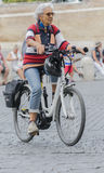 Lady who walks with his bicicleta in the center of Rome Royalty Free Stock Photo