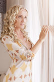 Lady at the window Royalty Free Stock Photos