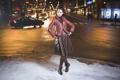 Lady in winter night city blurred background Stock Images