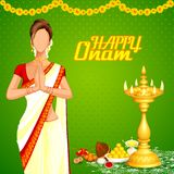 Lady wishing Happy Onam Royalty Free Stock Image