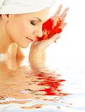 Lady With Red Petals In Water Royalty Free Stock Photos