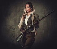 Free Lady With Shotgun And Hat From Wild West On Dark Background. Royalty Free Stock Photo - 76565395