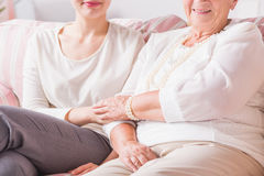 Lady and woman holding hands Stock Photography