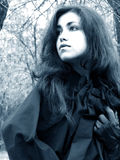 Lady of the woods #2. Beautiful woman with black cape and leather glove running royalty free stock photos