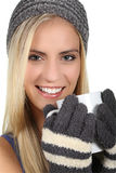 Lady in Woolen Gloves and Hat Keeping Warm Royalty Free Stock Images