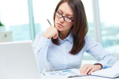 Lady at work. Image of a business lady being busy working Royalty Free Stock Images