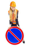 Lady Worker With Road Sign. Worker woman with prohibitory sign, isolated on white Royalty Free Stock Photos