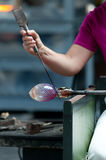 Lady working on glass artwork in the factory Royalty Free Stock Photography