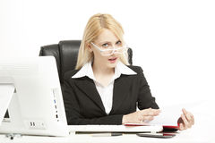 Lady working in her office Stock Photos