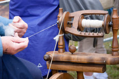 Lady Working Old Fashioned Spinning Wheel Royalty Free Stock Photo