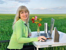 Lady works on a laptop. On the nature Royalty Free Stock Image