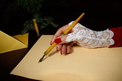 Lady writes letter with quill Royalty Free Stock Images