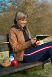Lady Writing Outdoors Stock Photo