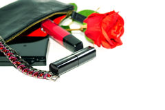Lady's goods: make up bag, cosmetics and fashion jewerly on white background with soft shadows. Royalty Free Stock Photos