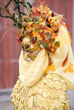 Lady in yellow. Woman in yellow dressed for the Venice Carnival with an autumnal mask Stock Photo